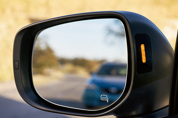 A close-up of a Blind-Spot Detection indicator light on the 2021 Crosstrek side mirror.