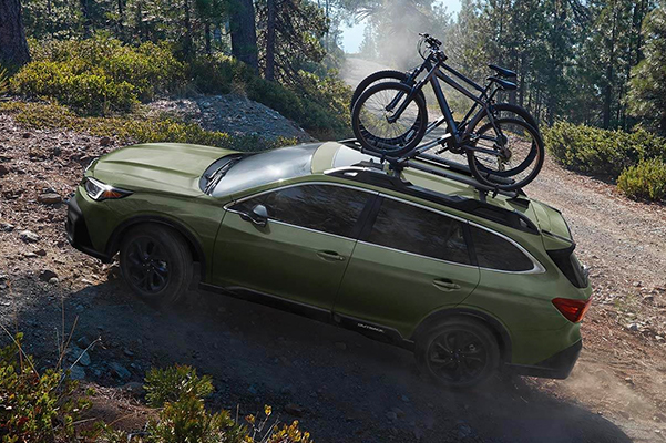2021 Subaru Outback off roading with 2 bikes mounted to the roof racks