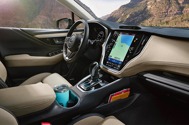 Interior shot of the drivers seat, steering column and touch screen navigation in a 2021 Subaru Outback