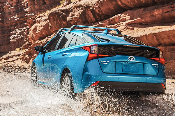 Blue Toyota Prius driving off road