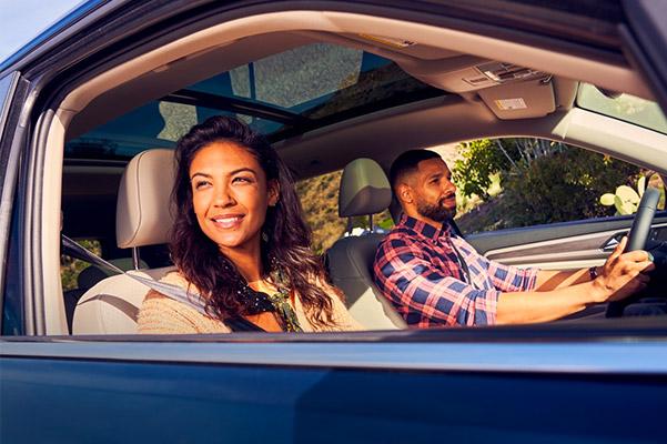 Couple driving in a 2021 Volkswagen Atlas