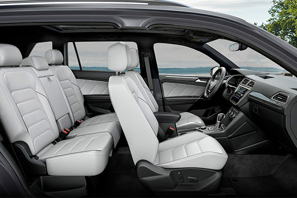A side profile of a Tiguan showcasing its interior in available Storm Gray Vienna leather.