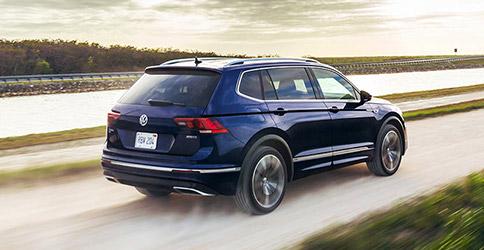 2021 Volkswagen Tiguan rear driving on road
