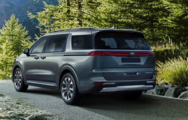 Rear shot of the 2022 Kia Sedona parked in a rural area