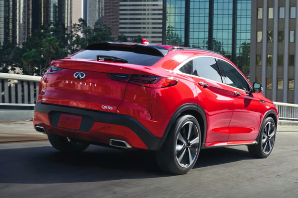 Rear exterior view of 2022 INFINITI QX55 Crossover Coupe with city in background