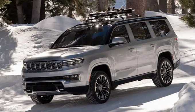 2022 Jeep Grand Wagoneer driving on snowy road