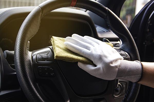 A man cleaning car interior, car detailing.