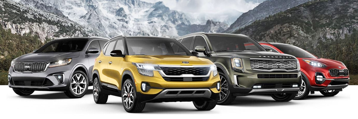 2020 Kia SUV lineup with mountain background.