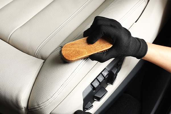 Worker washing of interior leather seats