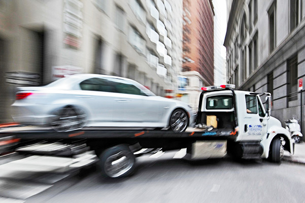 tow truck delivers vehicle